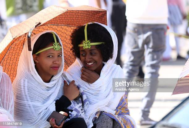 Ethiopian Orthodox Christians wearing leaf crowns made out of date palm gather to attend the Hosanna Day celebrations ahead of the Easter at the Bole...