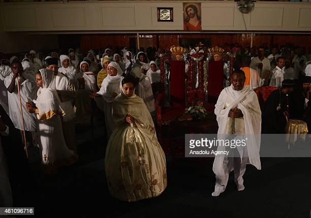 Ethiopian Orthodox Christians who follow the Julian calendar attend a Christmas Eve mass at the Holy Trinity Ethiopian Orthodox Tewahedo Church in...