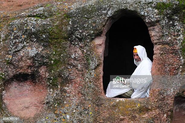 ethiopian orthodox monk in window - ethiopia photos stock pictures, royalty-free photos & images