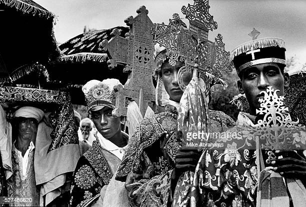 Ethiopian Orthodox pilgrims at Lalibela Ethiopia Priests carrying a Tabot a model of The Ark of the Covenant wrapped in a rich cloth and carried on...