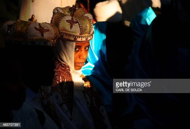 Ethiopian Orthodox pilgrims attend a ceremony at the Fasilides baths during the Timkat festival in Gondar on January 19 2014 Timkat is the Ethiopian...