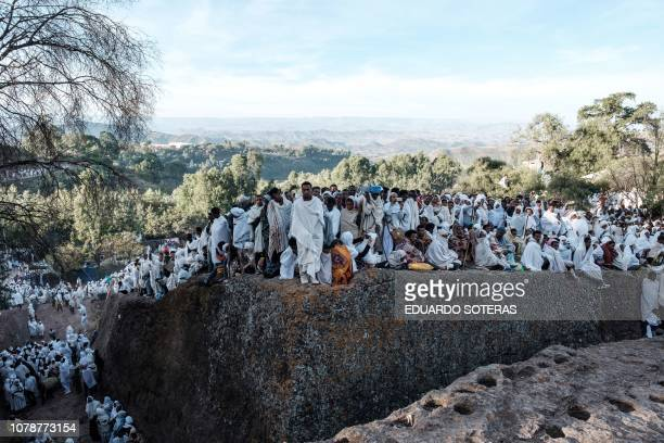 Ethiopian Orthodox pilgrims attend during their Christmas celebration at Saint Mary's Church in Lalibela Ethiopia on January 7 2019 The Ethiopian...