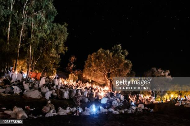 Ethiopian Orthodox pilgrims attend the Christmas eve celebration at Saint Mary's Church in Lalibela Ethiopia on January 7 2019 The Ethiopian Orthodox...