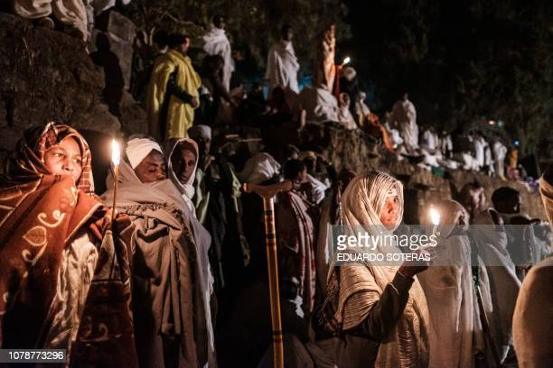 TOPSHOT Ethiopian Orthodox pilgrims attend the Christmas eve celebration at Saint Mary's Church in Lalibela Ethiopia on January 7 2019 The Ethiopian...