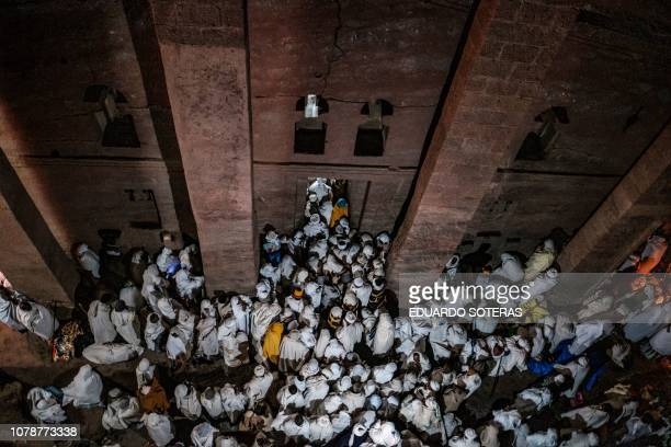 TOPSHOT Ethiopian Orthodox pilgrims attend the Christmas Eve celebration at Savior's Church in Lalibela Ethiopia on January 7 2019 The Ethiopian...