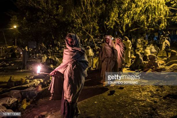 Ethiopian Orthodox pilgrims attend their Christmas Eve celebration at the Saint Mary's Church in Lalibela Ethiopia on January 7 2019 The Ethiopian...