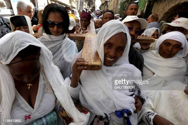 Ethiopian Orthodox pilgrims carry a cross along the Via Dolorosa , during theOrthodox Good Friday procession in Jerusalem's Old City on April 26,...