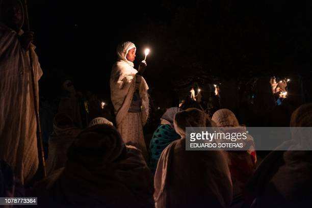 Ethiopian Orthodox pilgrims hold candles as they attend their Christmas Eve celebration at the Saint Mary's Church in Lalibela Ethiopia on January 7...