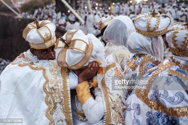 TOPSHOT Ethiopian Orthodox pilgrims rest as they attend their Christmas Eve celebration at the Saint Mary's Church in Lalibela Ethiopia on January 7...