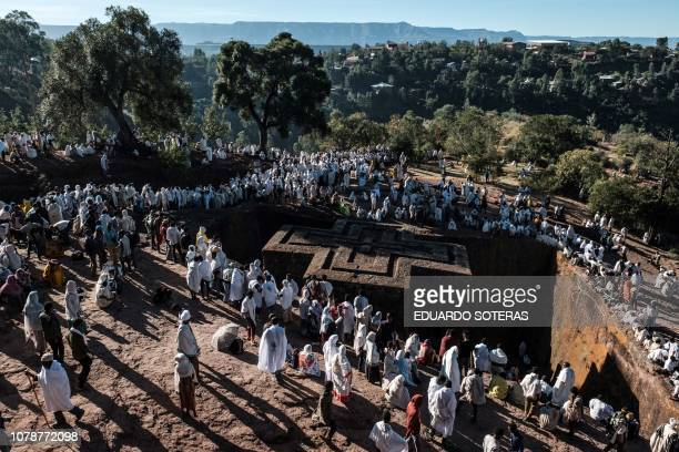 Ethiopian Orthodox pilgrims take part in the Christmas Eve celebration at Saint George Church in Lalibela on January 06 2019 The Ethiopian Orthodox...