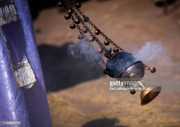 Ethiopian orthodox priest spreading insence with a censer during timkat epiphany festival Lalibela Ethiopia on January 19 2014 in Lalibela Ethiopia