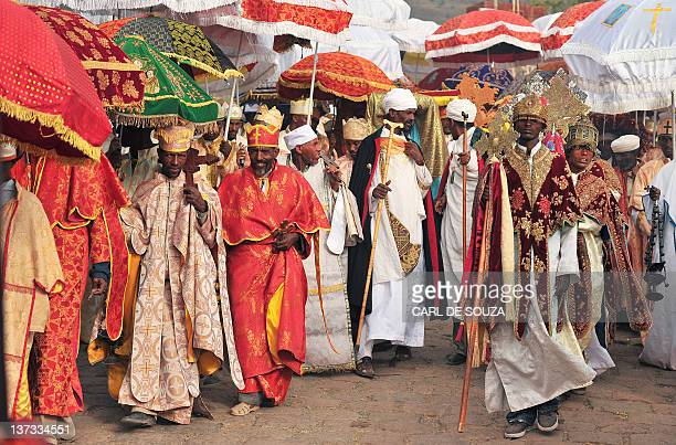Ethiopian Orthodox Priests and monks are pictured walk the annual festival of Timkat in Lalibela Ethiopia which celebrates the Baptism of Jesus in...