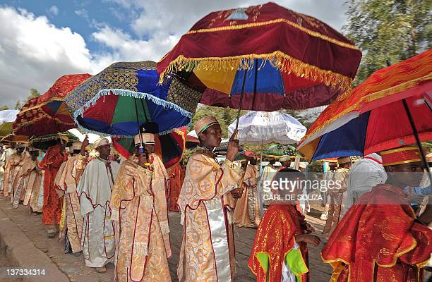 Ethiopian Orthodox Priests and Monks walk during the annual festival of Timkat in Lalibela Ethiopia which celebrates the Baptism of Jesus in the...