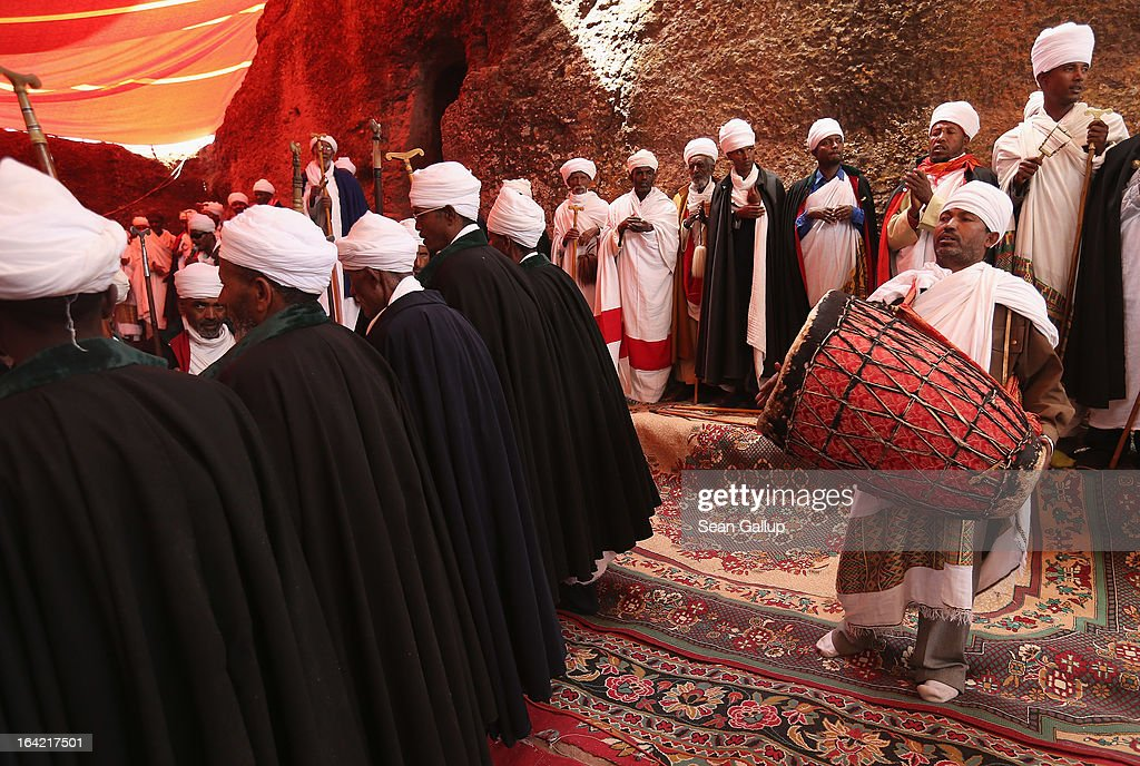 Ethiopian Orthodox priests and other clergy members peform a ritual involving song, dance and a small procession outside Bete Maryam, als called St. Mary's, Church on the occasion of the visit of German President Joachim Gauck at the Lalibela holy sites on March 19, 2013 in Lalibela, Ethiopia. Lalibela is among Ethiopia's holiest of cities and is distinguished by its 11 Christian churches hewn into solid rock that date back to the 12th century. Construction of the churches was begun by Ethiopian Emperor Gebre Mesqel Lalibela, who sought to create an alternative pilgrimage site after the Muslim occupation of Jerusalem in 1187. Lalibela was the capital of Ethiopia until the 13th century.
