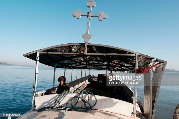 Ethiopian Orthodox priests are seen inside a boat on the shore of Lake Tana, in Bahir Dar, Ethiopia, on January 29, 2021.
