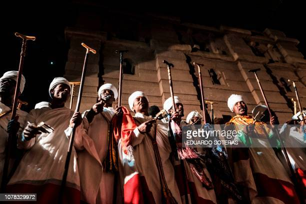 Ethiopian Orthodox priests attend a celebration at Saint Emmanuel's Church in Lalibela Ethiopia on January 05 2019 The Ethiopian Orthodox Christmas...