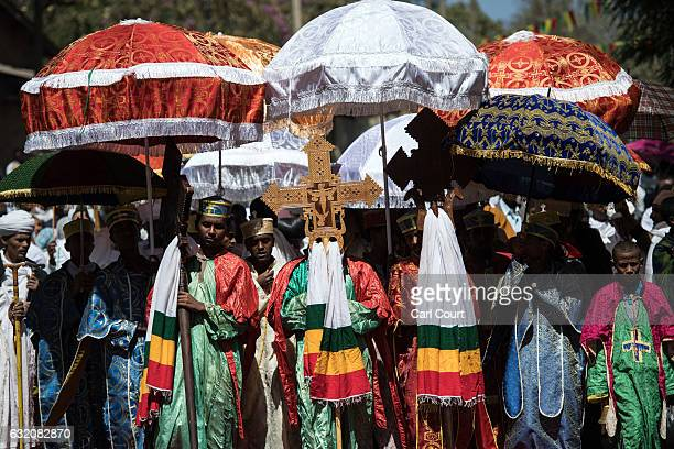 Ethiopian Orthodox priests carry a Tabot during a procession to mark the annual Timkat epiphany celebration on January 18 2017 in Gondar Ethiopia...
