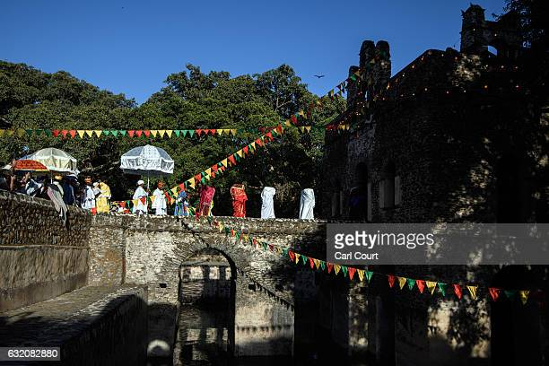 Ethiopian Orthodox priests carry Tabots into the tower at Fasilides Bath during the annual Timkat epiphany celebration on January 18 2017 in Gondar...