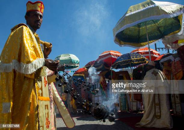 Ethiopian orthodox priests with censers celebrating the colorful Timkat epiphany festival on January 19 2017 in Lalibela Ethiopia