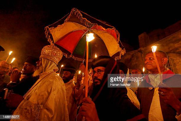 Ethiopian Orthodox procession around the dome of Deir es Sultan at the Church of the Holy Sepulchre on Holy Saturday, Easter.