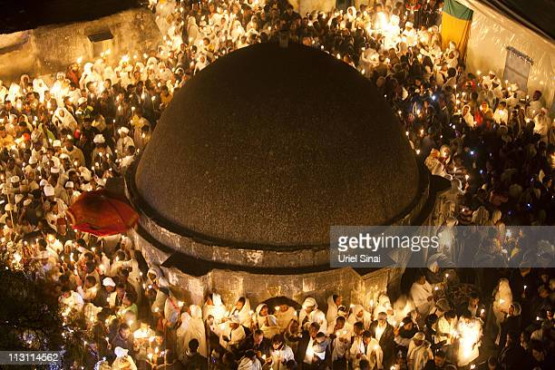 Ethiopian Orthodox worshippers celebrate the Holy Fire ceremony at the Ethiopian section of the Church of the Holy Sepulchre April 23 2011 in...