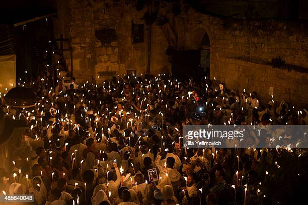Ethiopian Orthodox worshippers light candles and pray during the Holy Fire ceremony at the Deir AlSultan the Ethiopian section of the Church of the...