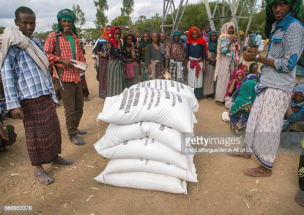Ethiopian people wait at a food distribution centre semien wollo zone woldia Ethiopia on February 24 2016 in Woldia Ethiopia
