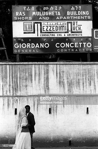 Ethiopian people walking near the building site of Giordano Concetto's company Many Italian building firms are operating in the city Addis Ababa...