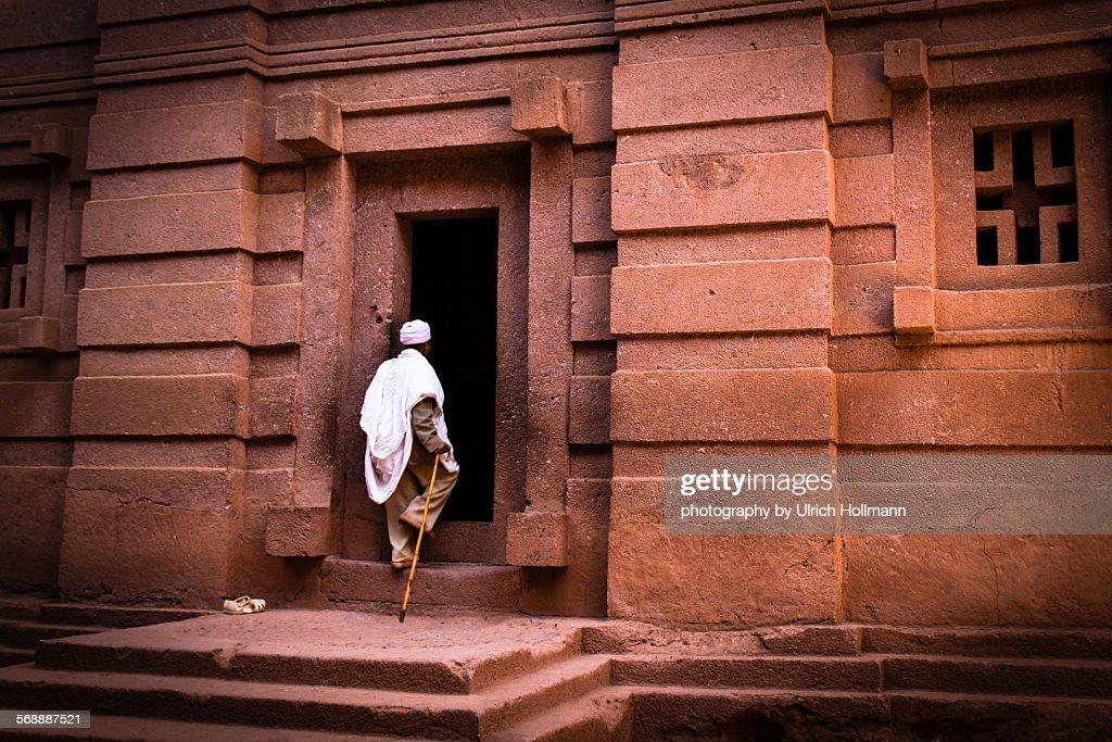 Ethiopian priest at rock hewn church : Stock Photo