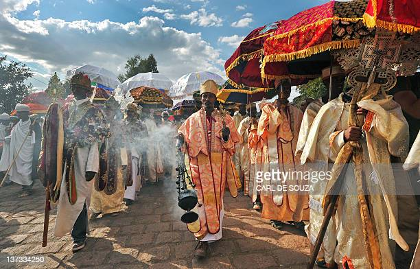 Ethiopian priests and monks walk during the annual festival of Timkat in Lalibela Ethiopia which celebrates the Baptism of Jesus in the Jordan River...