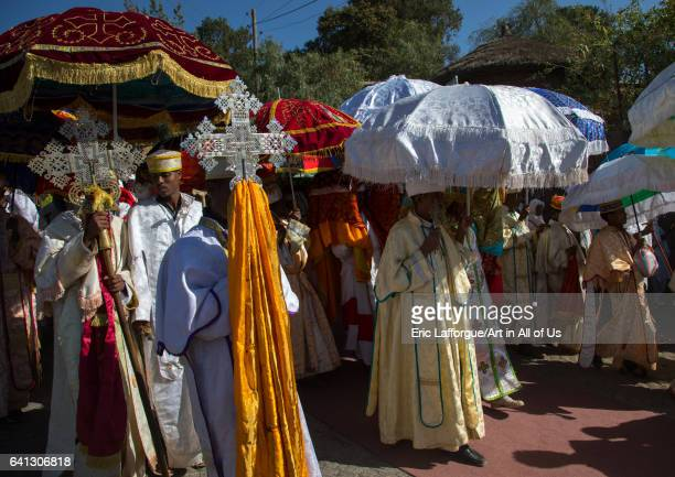 Ethiopian priests carrying some covered tabots on their heads during Timkat epiphany festival on January 18 2017 in Lalibela Ethiopia