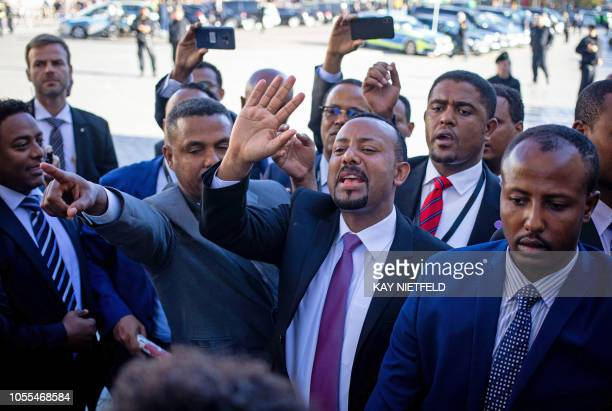 Ethiopian Prime Minister Abiy Ahmed Ali is greeted as he arrives for a G20 Investment Summit during the 'Compact with Africa' conference on trade aid...