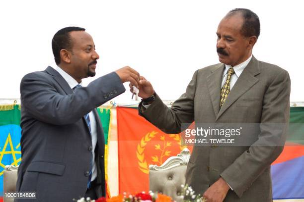 Ethiopian Prime Minister Abiy Ahmed and Eritrean President Isaias Afwerki celebrate the reopening of the Embassy of Eritrea in Ethiopia in Addis...