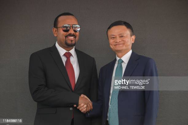 Ethiopian prime minister Abiy Ahmed and Jack Ma, co-founder and former executive chair of Chinese Alibaba Group, pose for a photogaph during the...