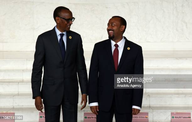 Ethiopian Prime Minister Abiy Ahmed and Rwandan President Paul Kagame are seen together ahead of posing for a family photo following the 11th...