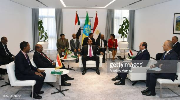 Ethiopian Prime Minister Abiy Ahmed Egyptian President Abdel Fattah alSisi and Sudans President Omar Al Bashir take part in a tripartite summit...