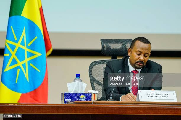 Ethiopian Prime Minister Abiy Ahmed looks on at the House of Peoples Representatives in Addis Ababa, Ethiopia, on November 30, 2020 to respond to the...
