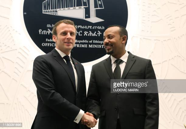 Ethiopian Prime Minister Abiy Ahmed shakes hands with French President Emmanuel Macron after signing agreements on March 12 2019 in Addis Ababa