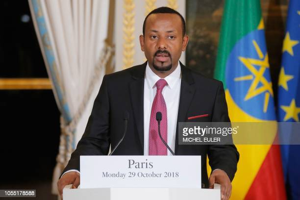 Ethiopian Prime Minister Abiy Ahmed speaks during a joint press conference with French President following their meeting at the Elysee Palace, in...