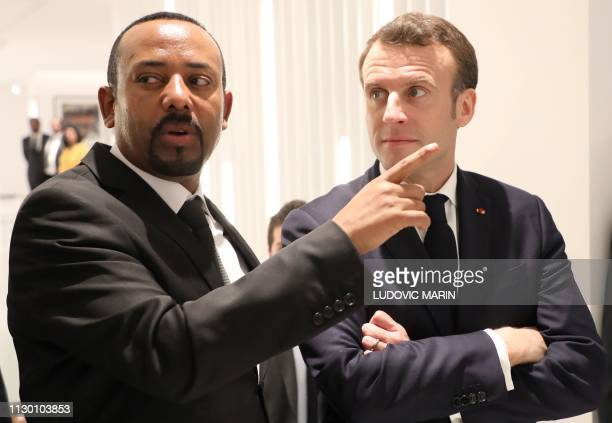 Ethiopian Prime Minister Abiy Ahmed speaks with French President Emmanuel Macron before a meeting in Addis Ababa on March 12 2019