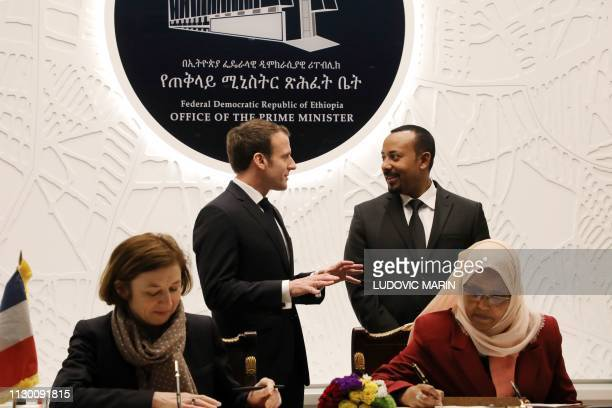 Ethiopian Prime Minister Abiy Ahmed speaks with French President Emmanuel Macron while French Defence Minister Florence Parly and her Ethiopian...