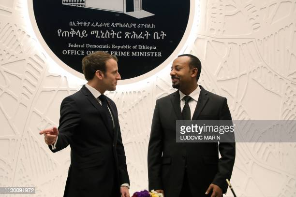 Ethiopian Prime Minister Abiy Ahmed speaks with French President Emmanuel Macron after signing agreements on March 12 2019 in Addis Ababa