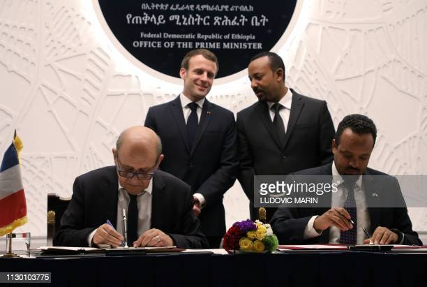Ethiopian Prime Minister Abiy Ahmed speaks with French President Emmanuel Macron while French Foreign Minister JeanYves Le Drian and Ethiopian...