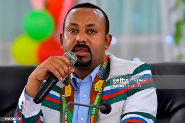 Ethiopian Prime Minister Abiy Ahmed, wearing a white coat bearing the traditional Kafficho colours of red, green and blue, address the crowd in...