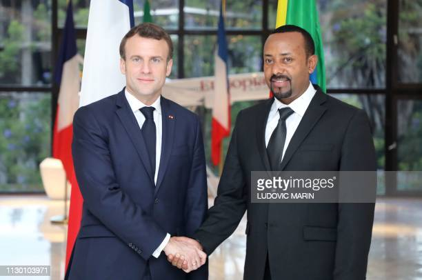 Ethiopian Prime Minister Abiy Ahmed welcomes French President Emmanuel Macron before a meeting in Addis Ababa on March 12 2019