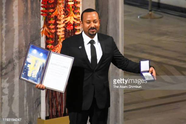 Ethiopian Prime Minister and Nobel Peace Prize Laureate Abiy Ahmed Ali poses on stage after being awarded with the Nobel Peace Prize during the Nobel...