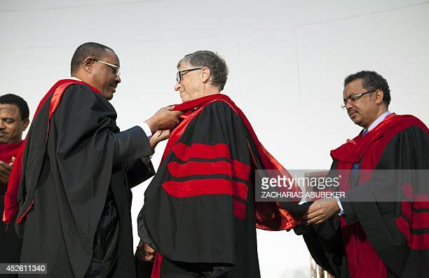 Ethiopian Prime Minister Hailemariam Desalegn places a sash on US businessman and philanthropist Bill Gates cochair of Bill and Melinda Gates...