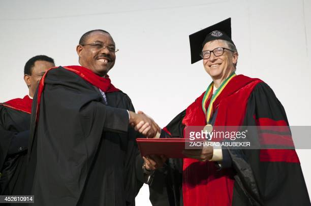 Ethiopian Prime Minister Hailemariam Desalegn shakes hands with Bill Gates cochair of Bill and Melinda Gates Foundation as he hands him an honourary...