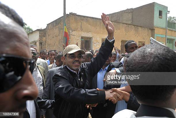 Ethiopian Prime Minister Meles Zenawi greets supporters as he arrives on May 232010 to cast his vote at a polling station in Adwa 900 kms north of...