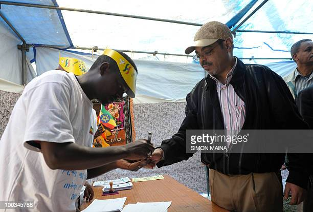 Ethiopian Prime Minister Meles Zenawi has his finger marked moments after casting his vote in at polling station in Adwa 900km north of the capital...